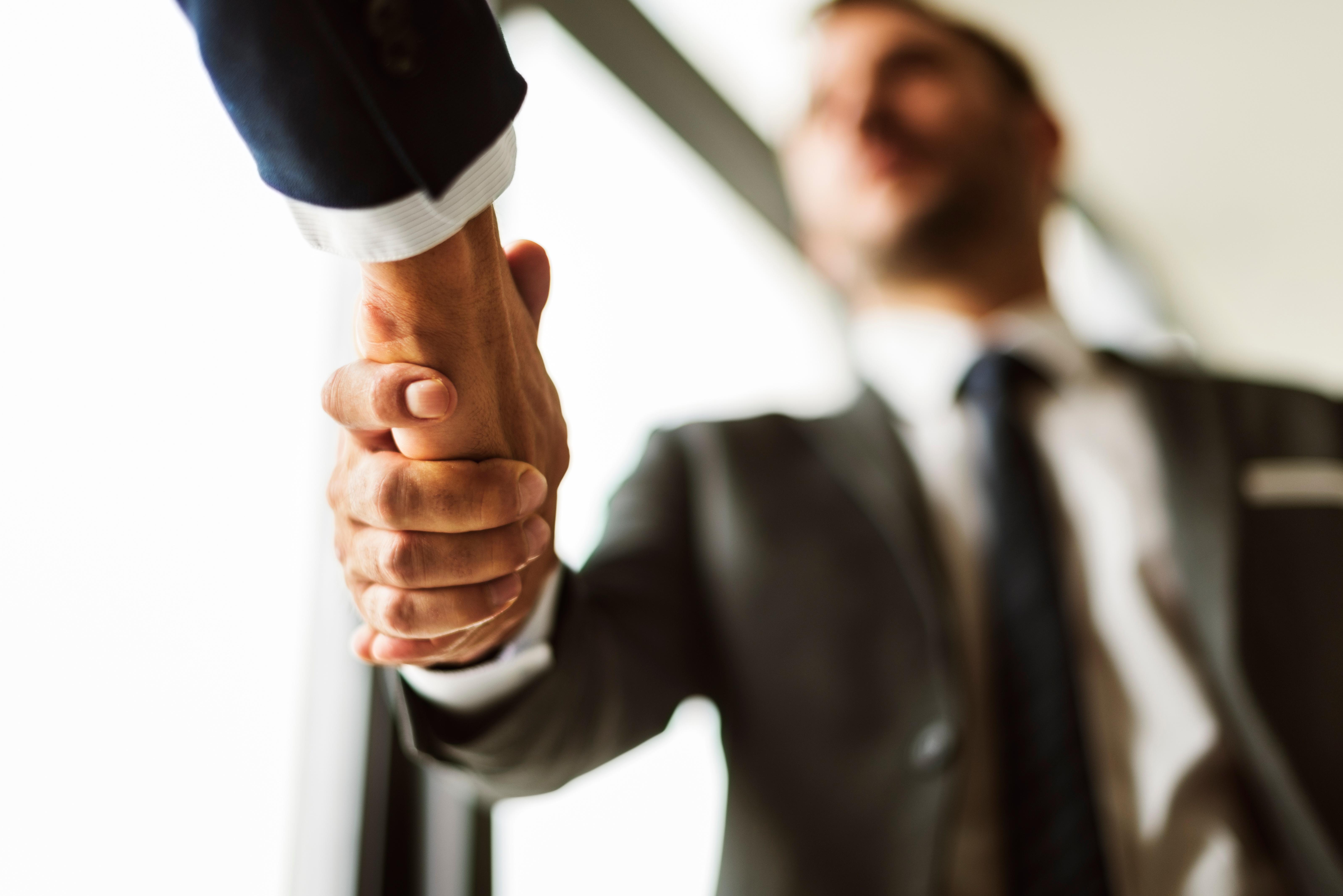 deal-businessmen-handshake-partnership-concept-PF3GLKS.jpg